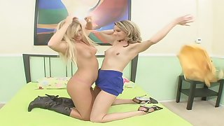 Blonde lesbian teen goes to bed with a strap on and makes her friend cum