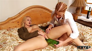 Marketable tipsy nympho Bambi Bell lets chick polish pussy with a bottle